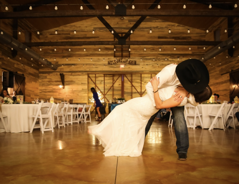 dip kiss at barn wedding